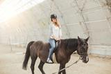 Fototapeta Fototapety z końmi - girl with a horse on the racetrack © rostov777
