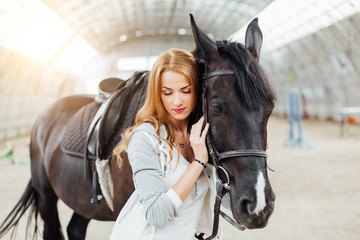girl with a horse on the racetrack