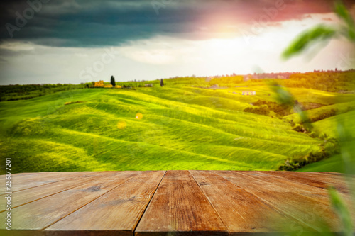 Desk of free space for your decoration and spring landscape of tuscany