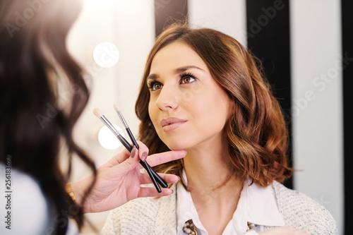 Portrait of gorgeous caucasian brunette at beauty salon.