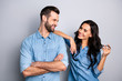 Leinwandbild Motiv Portrait of cute pleasant adorable guy lady trying to go on date touching shoulder curls by hand fingers looking tender gentle wearing denim outfit on argent background