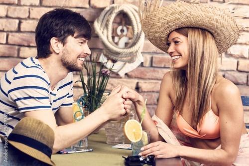 Leinwanddruck Bild Romantic couple enjoying summer holiday