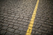 Yellow line on paving stone as abstract background