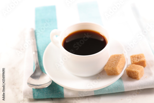 black coffee cup and sugar