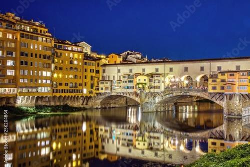 Leinwanddruck Bild  Ponte Vecchio in Florence, Italy, on a summer night.