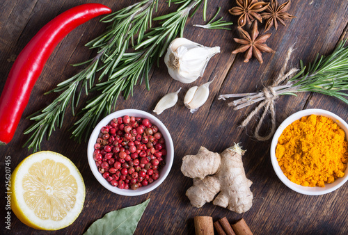 Herbs and spices in ceramic bowls. Aromatic ingredients and natural food additives. © Pakhnyushchyy
