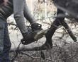 lumberjack sawing wood - 256221425