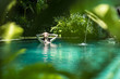 Leinwanddruck Bild - Sensual young woman relaxing in outdoor spa infinity swimming pool surrounded with lush tropical greenery of Ubud, Bali. Wellness, natural beauty and body care concept.
