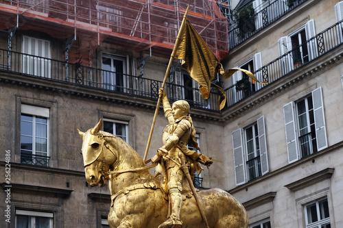 Golden statue of Joan of Arc on horseback in Paris