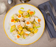 Tasty salad with chicken,  egg and sweet pineapple