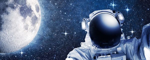 Astronaut in outer space, Moon in the background - Some elements of this image furnished by NASA