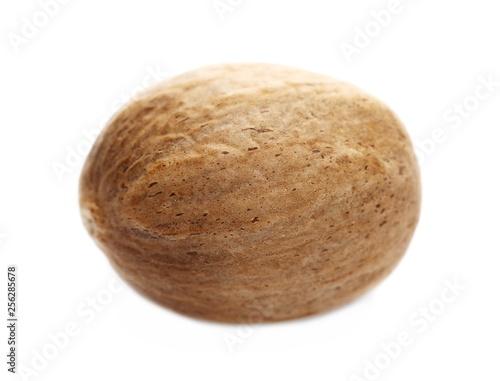 Macro nutmeg isolated on white background