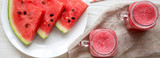 Watermelon smoothie in glass jars with fresh slices of water melon, overhead view. Flat lay, top view, from above.