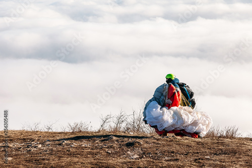 The paraglider carries the parachute to the jump site. © slayer87