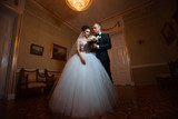 Wedding photo in a chic room.Couple in love