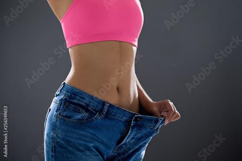 Leinwandbild Motiv woman loses weight