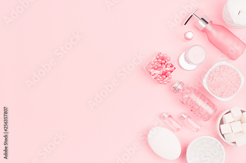 Cosmetics for salon aromatherapy, massage or bathroom - bath salt, cream, essential oil, soap, bowls, bottles, jewelry on elegance pink background. © finepoints
