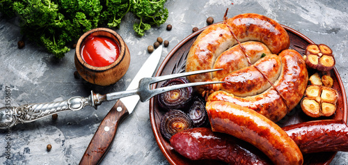 Tasty grilled pork sausages - 256359687