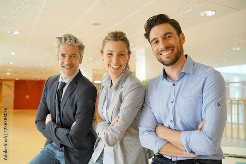 Attractive mixed business team smiling at camera