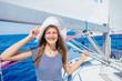 Leinwandbild Motiv Beautiful Girl relaxing On Yacht in Greece