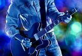 rock guitarist playing on stage