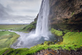 Famous natural landmark Seljalandsfoss waterfall in Iceland