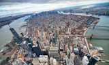 Wide angle aerial view of Downtown Manhattan, Brooklyn and Manhattan Bridges from helicopter, New York City