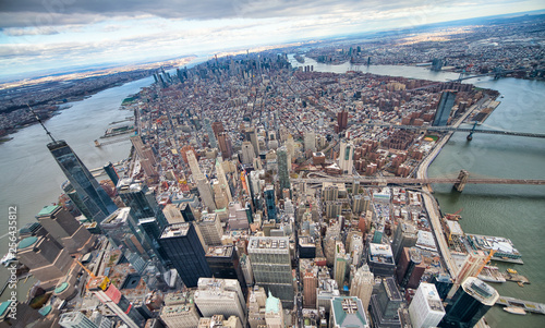 Wide angle aerial view of Downtown Manhattan, Brooklyn and Manhattan Bridges from helicopter, New York City © jovannig