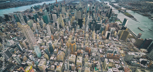 Wide angle aerial view of Midtown Manhattan, Central Park and Roosevelt Island from helicopter, New York City