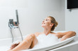 Leinwanddruck Bild - attractive, blonde and smiling woman taking bath with foam in bathroom