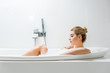 Leinwanddruck Bild - beautiful and blonde woman taking bath with foam and looking at away in bathroom