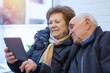 older couple or grandparents with a digital tablet or laptop