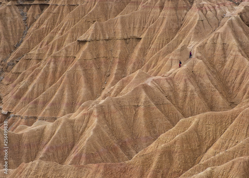 Two people in the passage of the deer in the desert of the Bardenas, Navarra