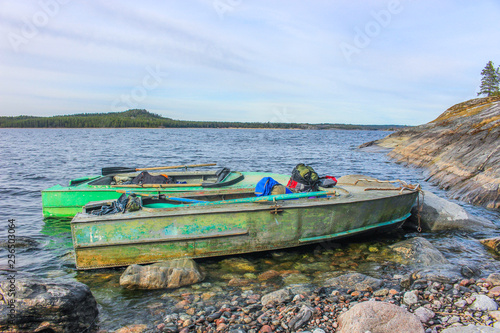 Two boats at the rocky shore