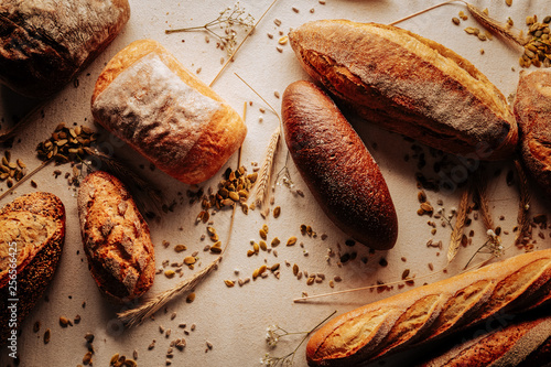 Top view of wheat and rye bread lying on table near seeds