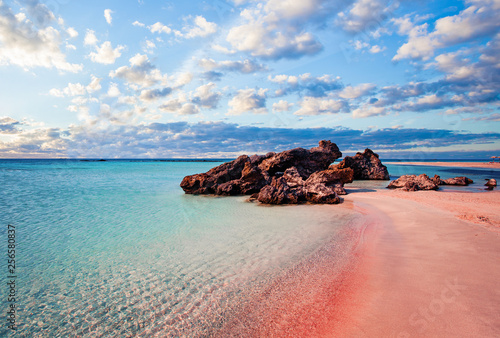 Crete skyline. Elafonissi beach with pink sand against blue sky with clouds on Crete, Greece - 256580837