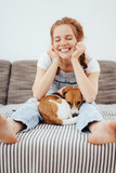 Cute young woman with her small dog