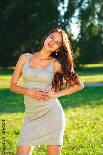 Leinwanddruck Bild Closeup portrait of a happy young woman smiling