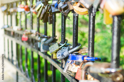 Hinged love locks hanging on a bridge - 256601470