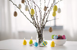 holidays and object concept - pussy willow branches decorated by easter eggs in vase and candles on table - 256607042