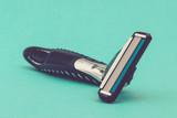Shaving Razor on Green