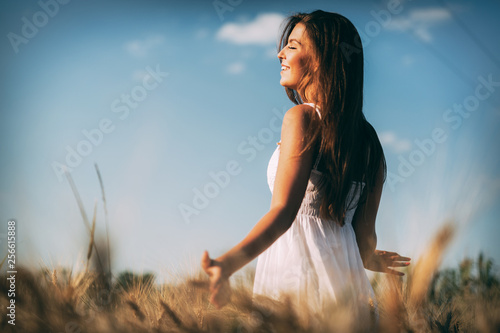 Young beautiful woman spending time in nature © nd3000