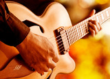 hot jazz guitarist playing on stage