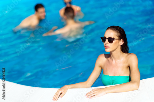 Group of people partying in pool