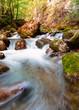 water flowing around rocks - 256624253