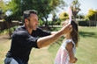 Man putting a rabbit ear headband on her daughter
