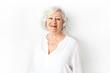 Leinwanddruck Bild - A Senior woman studio isolated on grey wall laughing cheerful