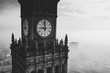 Big old clock face Palace of Culture and Science in foggy Warsaw city Poland
