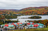 Scenic view over Mont Tremblant resort, colorful foliage of the surrounding forest, Quebec, Canada