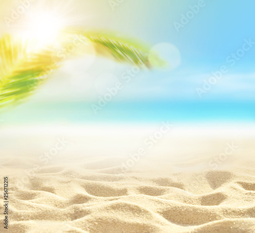 Leinwanddruck Bild Sand with Palm and tropical beach bokeh background, Summer vacation and travel concept. Copy space